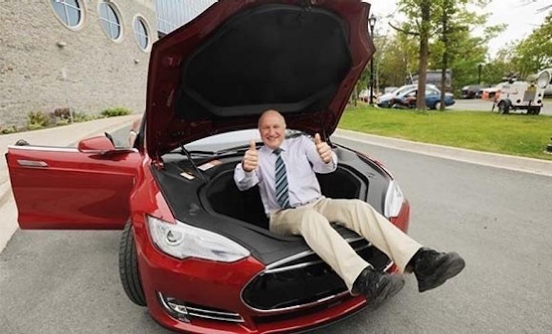 Battery expert Jeff Dahn inside the frunk of a red Model S
